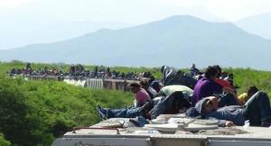 140706-mexico-border-train-migrant-11a_60cbe8166b401421a3487f8184e20e32